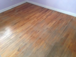 Solid Red Oak wood floor in San Marco, Jacksonville, Florida home, before refinishing