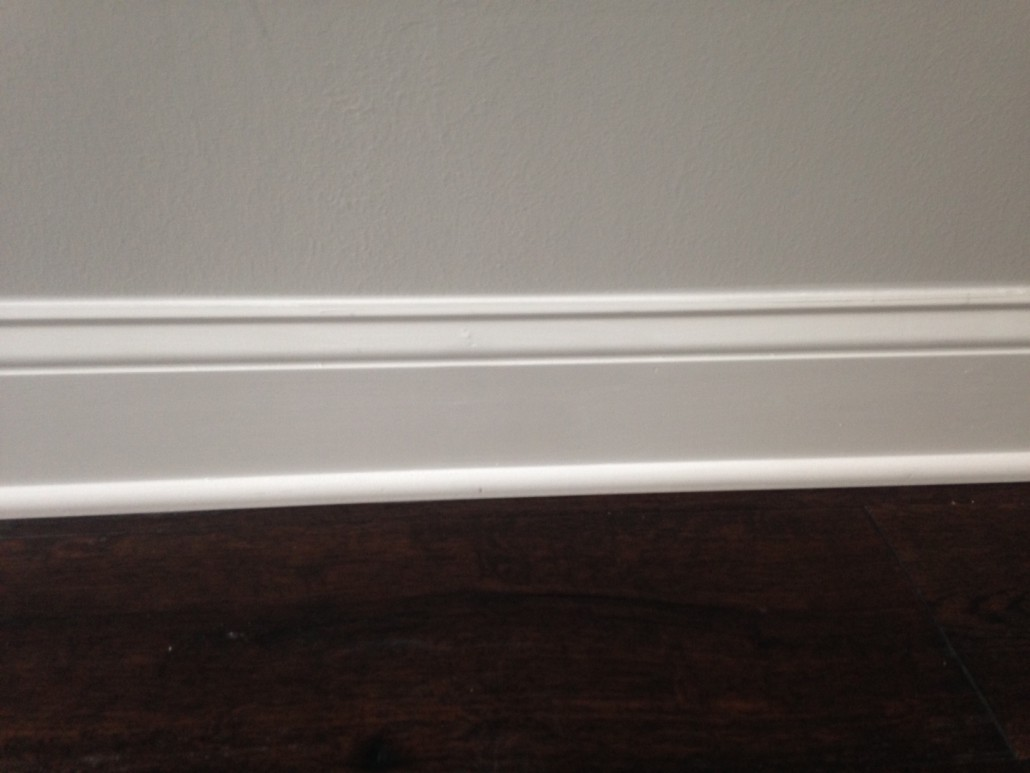 New, engineered European Oak Wood Flooring installed - baseboard details.