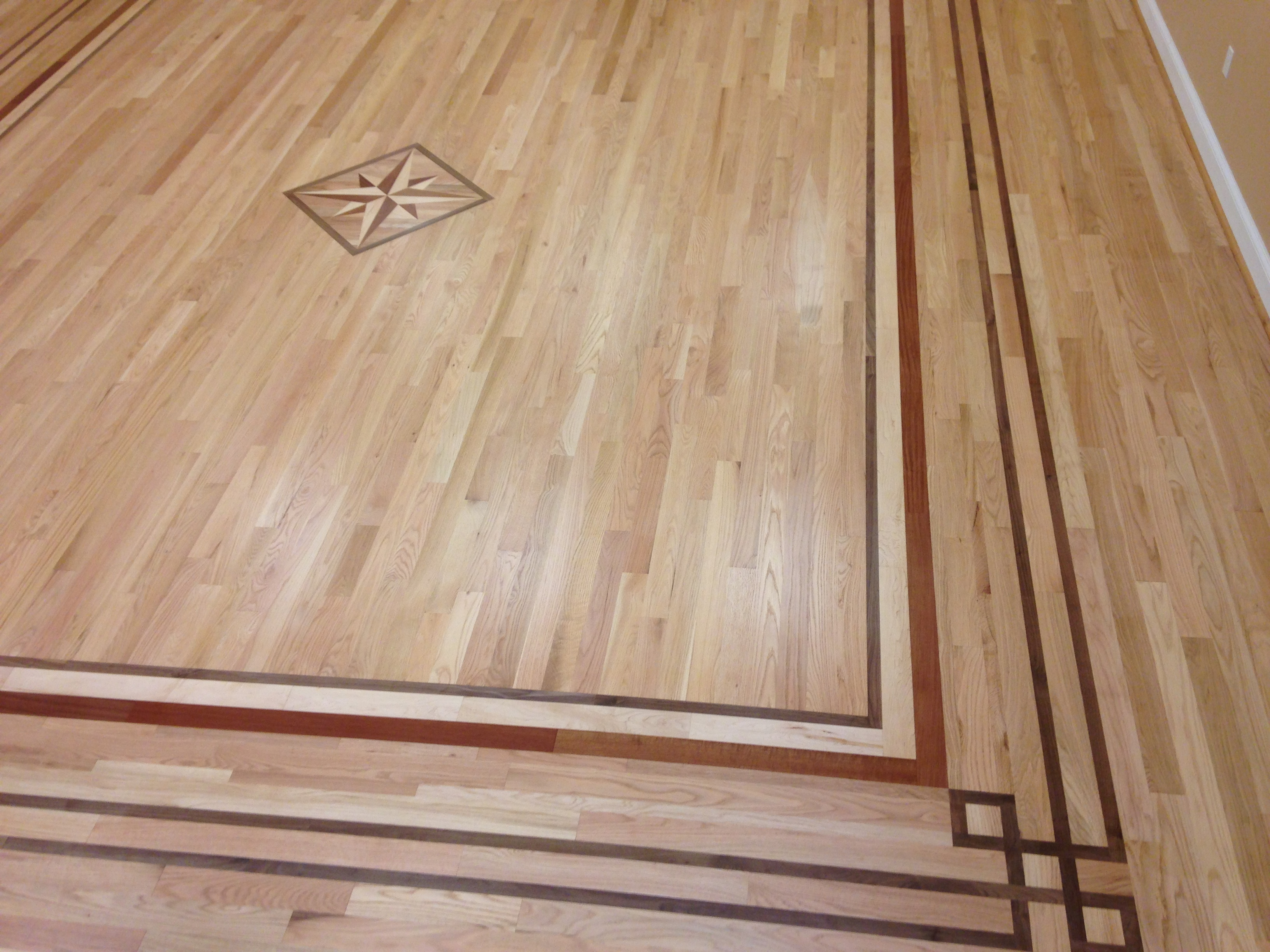 Medallions borders and inlays for jacksonville ponte for Hardwood floor designs borders