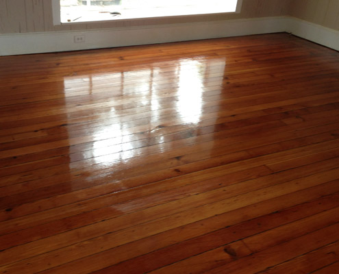 Refinished Heart Pine solid wood flooring.