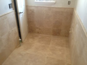 Travertine floor and wall, with wainscot
