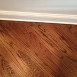Close up of edge work on finished hardwood floors