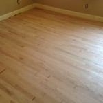 Light sanding prepares hardwood floors for stain and finish