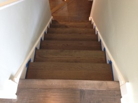 Solid Oak stair treads refinished to match Maple wood flooring color