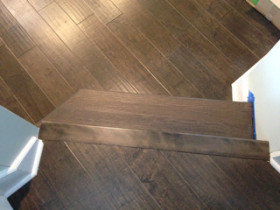 Solid Oak wood stair treads refinished to match Maple wood flooring in Atlantic Beach, Florida
