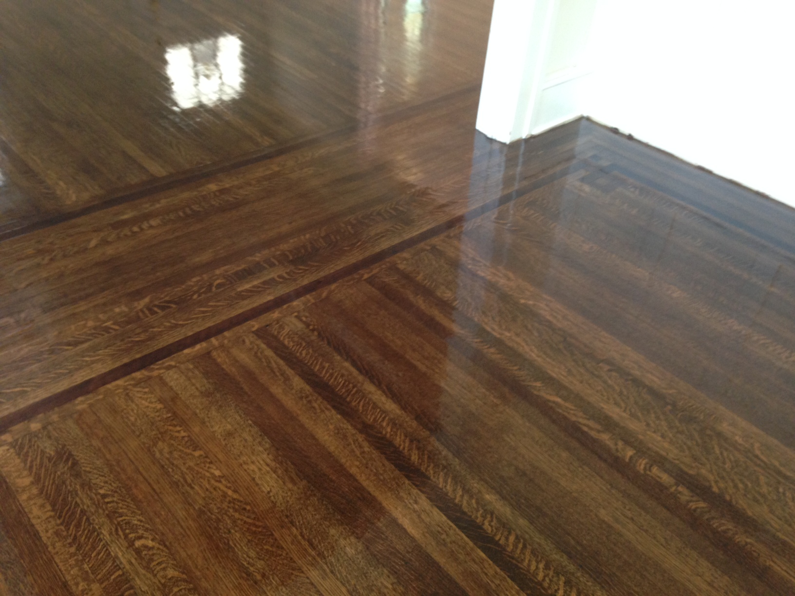 Refinished Old Hardwood Floors Shine As Finish Dries