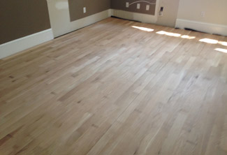 View of unfinished solid oak flooring installed