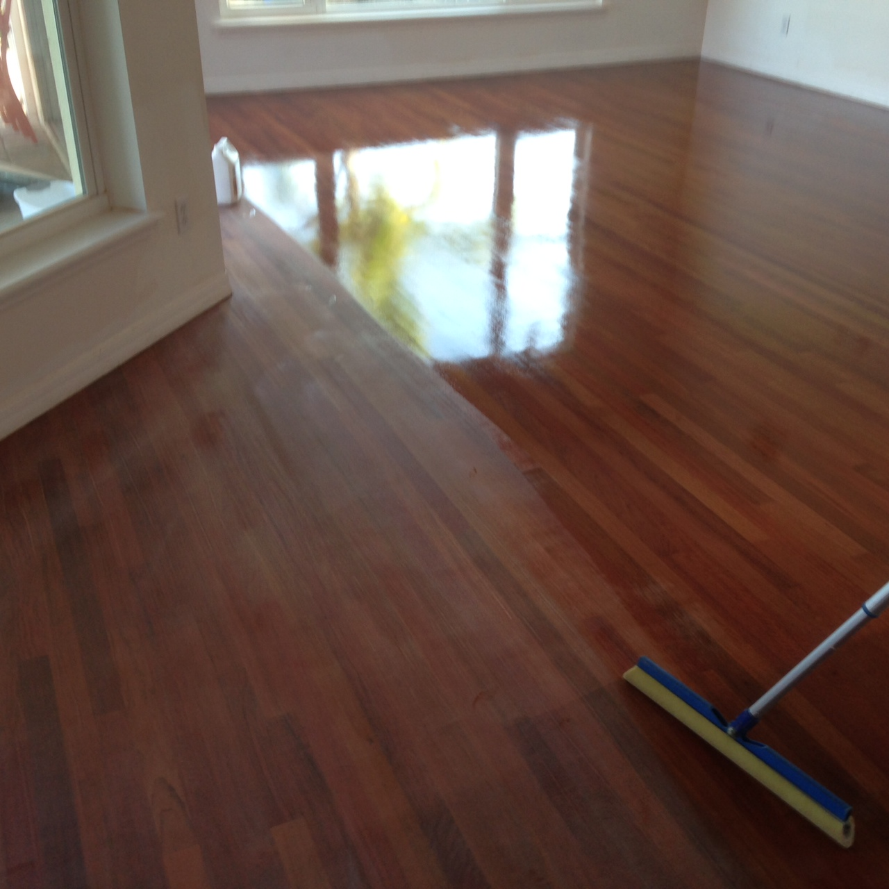 Brazilian Cherry Wood Floor getting Bona Polyurethane coating after  screening. - Brazilian Cherry Wood Floor Refinishing In St. Augustine, FL