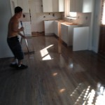Applying Bona Traffic polyurethane coating to finish refinishing wood floor