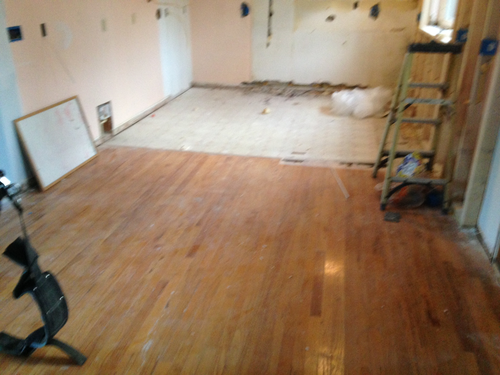 preparing to refinish wood floors in beach