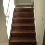 Bottom section of refinished wood stairs and landing