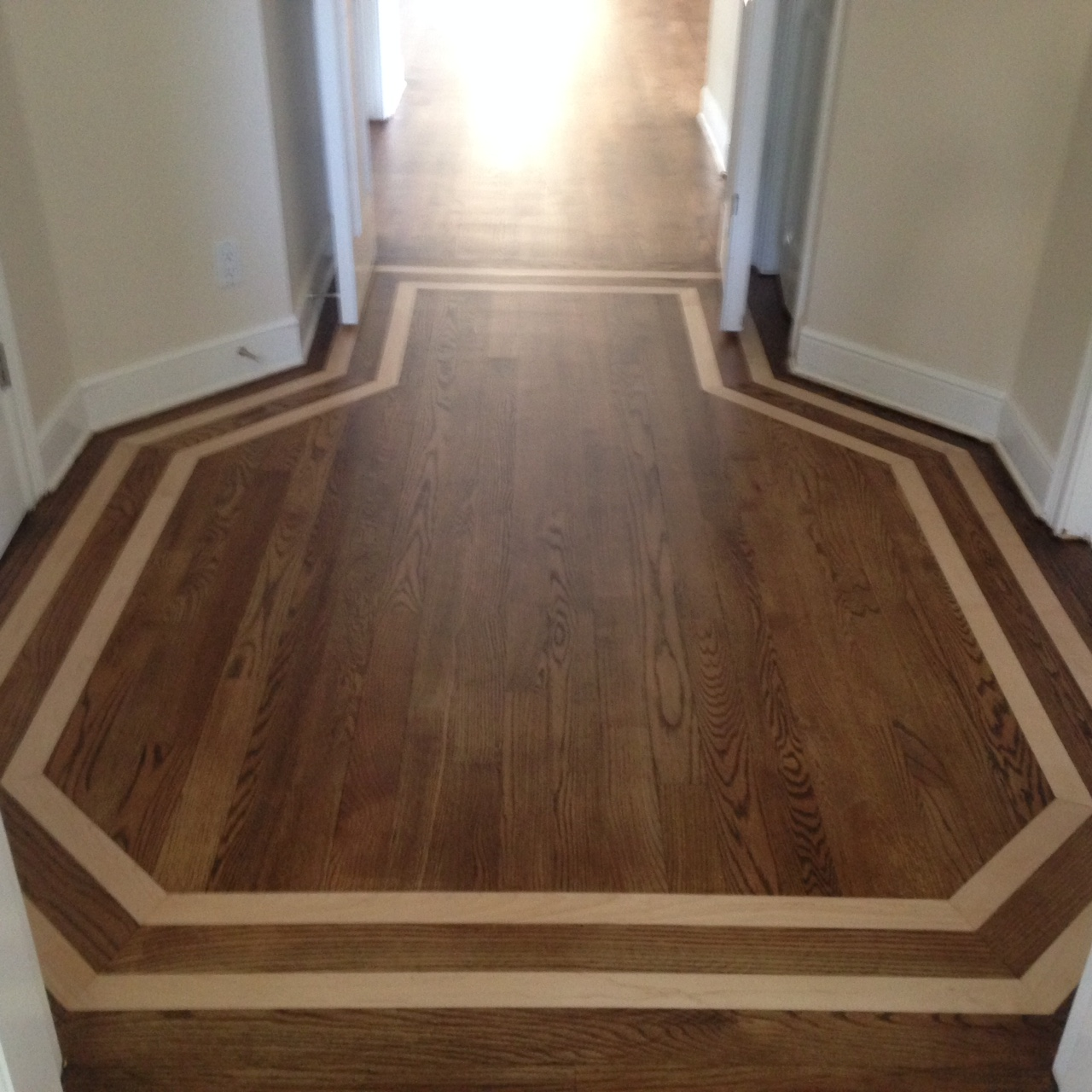 refinished red oak wood floor with inlay alternate view