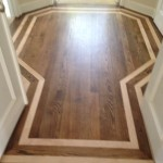 Refinished Red Oak wood floor with inlay