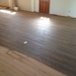 Sanding wood floor; staining preparation