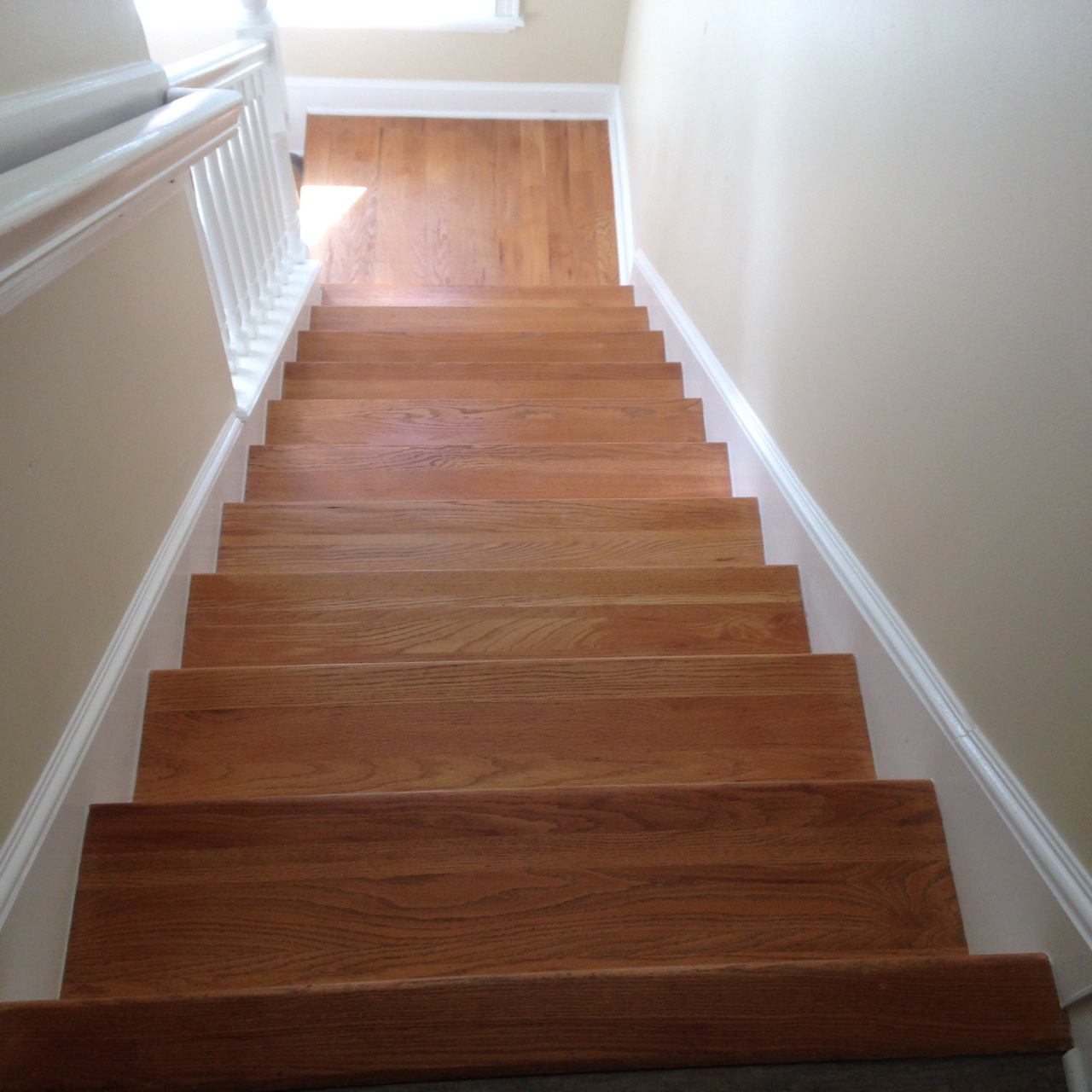 View from the top of wood stairs and landing to be refinished by sanding  and staining - Wood Floor Repair, Sand And Stain In Ponte Vedra FL