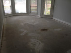 Bare subfloor ready for clean-up and wood flooring installation