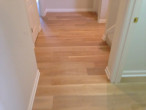 Wire brushed engineered White Oak wood flooring installed in the front hall