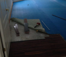 Taking up the blue carpet padding, as we begin to install wire brushed, engineered White Oak flooring