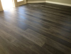 Blackish-gray, wire brushed White Oak flooring