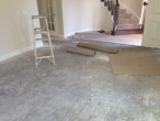 Carpet and padding removed from concrete subfloor for wood flooring installation