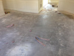 Carpet and padding removed from concrete slab subfloor for wood flooring installation