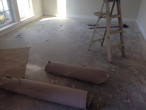 Carpet and carpet padding removed from concrete slab subfloor for wood flooring installation