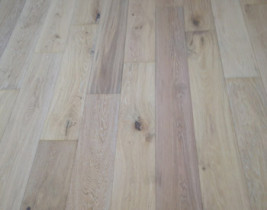 Installed wire brushed engineered white oak floor with white stain