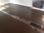 Leveling concrete slab subfloor for wood flooring installation