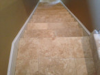 Looking down the travertine stairway
