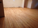 Neutral Duraseal stain applied to the sanded Red Oak floor