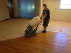 Sanding wood flooring at a 45 degree angle to remove cupping