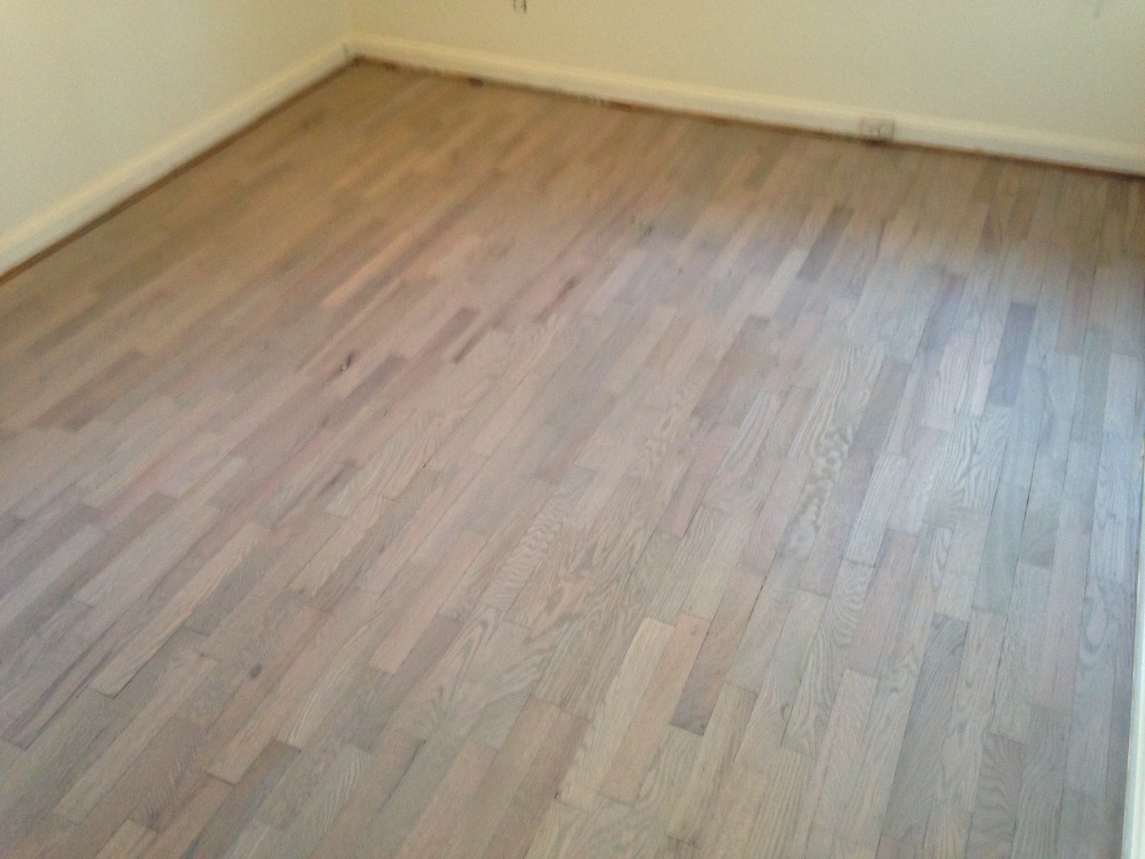 stained and refinished red oak floor for the beach house look
