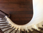 View of wire brushed, engineered White Oak wood flooring after installation, from the spiral staircase