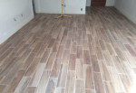 Faux wood floor tiles installed