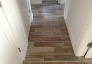 Wood look floor tile installed in hallway