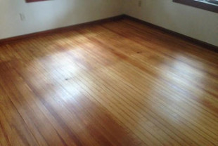 Elegant antique solid Heart Pine wood floor after restoration