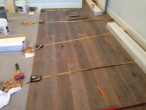Installing new European White Oak wood flooring using special wood floor straps