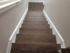 View of new European Oak wood floor and treads sanded and stained to match