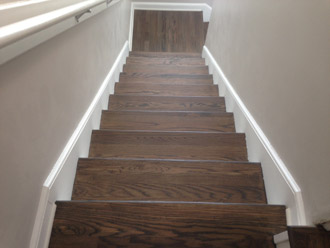 the second part of the project was to sand and stain the wooden stair treads to blend with the new european white oak wood floor