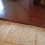 Existing carpeting lower level and existing wood flooring upper level