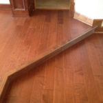 New Maple wood flooring installed with seams aligned on upper and lower levels
