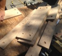 Boring holes for walnut plugs in white oak planks