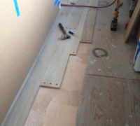 Gluing and nailing plug bored white oak planks in place