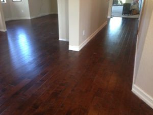 Installed - new engineered hand scraped birch wood flooring