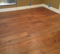 New European White Oak plank flooring, replacing Travertine tile floor