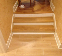 New solid Red Oak stair treads match existing floor on upper level