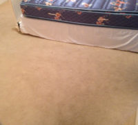 Old carpeting on the bedroom floor, to be removed by Dan's Floor Store of Ponte Vedra - 904.887.8303