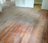 Solid Heart Pine wood floors in a home in historic Springfield before refinishing