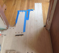 Weaving-in new bored white oak planks with existing pegged look white oak flooring