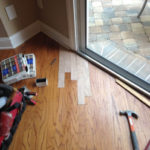 Wood flooring planks installed in second repair area